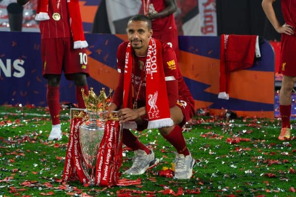 LIVERPOOL, ENGLAND - Wednesday, July 22, 2020: Liverpool's Joe Gomez celebrates with the Premier League trophy as his side are crowned Champions after the FA Premier League match between Liverpool FC and Chelsea FC at Anfield. The game was played behind closed doors due to the UK government's social distancing laws during the Coronavirus COVID-19 Pandemic. Liverpool won 5-3. (Pic by David Rawcliffe/Propaganda)