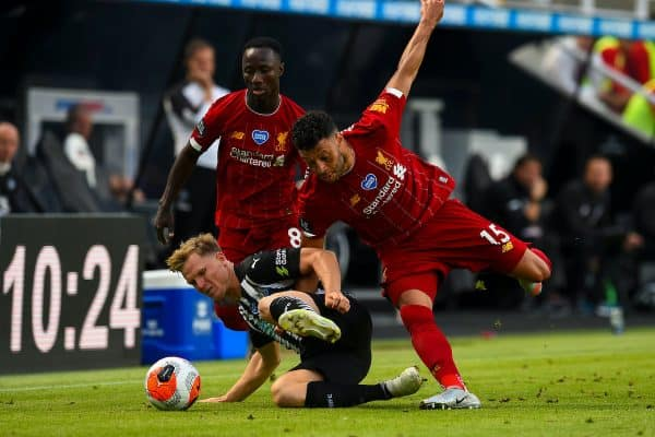 LIVERPOOL, ENGLAND - Sunday, July 26, 2020: Liverpool's Naby Keita (L) and Alex Oxlade-Chamberlain (R) challenge Newcastle United's Matt Ritchie during the final match of the FA Premier League season between Newcastle United FC and Liverpool FC at St. James' Park. The game was played behind closed doors due to the UK government's social distancing laws during the Coronavirus COVID-19 Pandemic. (Pic by David Rawcliffe/Propagandab)