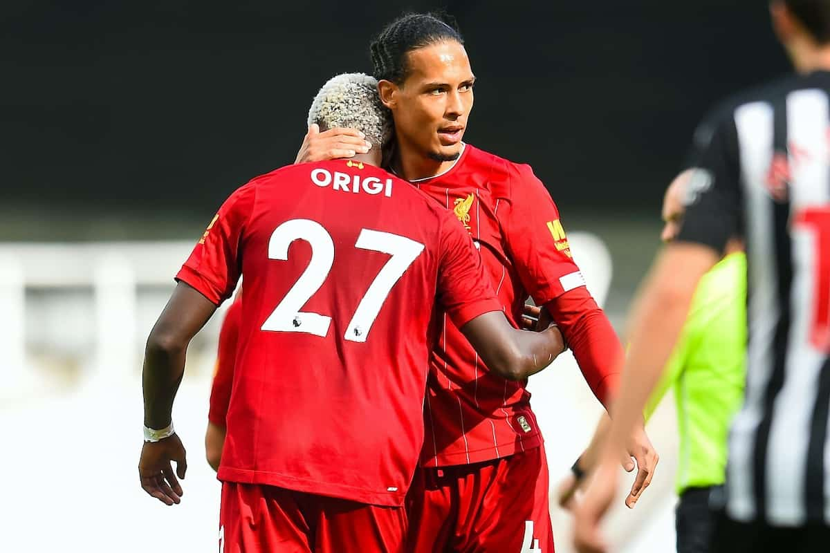 LIVERPOOL, ENGLAND - Sunday, July 26, 2020: Divock Origi (L) celebrates scoring the second goal with team-mate Virgil van Dijk during the final match of the FA Premier League season between Newcastle United FC and Liverpool FC at St. James' Park. The game was played behind closed doors due to the UK government's social distancing laws during the Coronavirus COVID-19 Pandemic. (Pic by Propaganda)