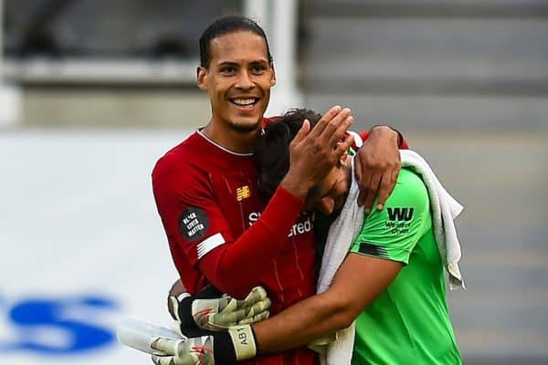 LIVERPOOL, ENGLAND - Sunday, July 26, 2020: Liverpool's Virgil van Dijk (L) celebrates with goalkeeper Alisson Becker after the final match of the FA Premier League season between Newcastle United FC and Liverpool FC at St. James' Park. The game was played behind closed doors due to the UK government's social distancing laws during the Coronavirus COVID-19 Pandemic. Liverpool won 3-1 and finished the season as Champions on 99 points. (Pic by Propaganda)