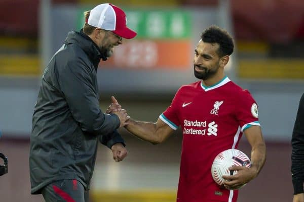LIVERPOOL, ENGLAND - Saturday, September 12, 2020: Liverpool's manager Jürgen Klopp congratulates hat-trick hero Mohamed Salah after the opening FA Premier League match between Liverpool FC and Leeds United FC at Anfield. The game was played behind closed doors due to the UK government's social distancing laws during the Coronavirus COVID-19 Pandemic. Liverpool won 4-3. (Pic by David Rawcliffe/Propaganda)