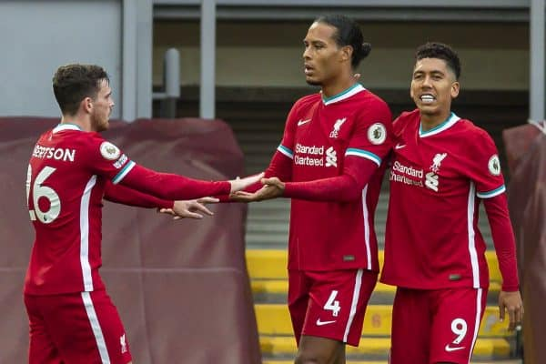 LIVERPOOL, ENGLAND - Saturday, September 12, 2020: Liverpool's Virgil van Dijk (C) celebrates scoring the second goal with team-mate Andy Robertson (L) during the opening FA Premier League match between Liverpool FC and Leeds United FC at Anfield. The game was played behind closed doors due to the UK government's social distancing laws during the Coronavirus COVID-19 Pandemic. (Pic by David Rawcliffe/Propaganda)