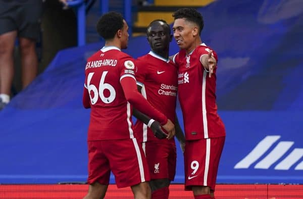 LONDON, ENGLAND - Sunday, September 20, 2020: Liverpool's Sadio Mané (C) celebrates with team-mates Trent Alexander-Arnold (L) and Roberto Firmino (R) after scoring the first goal with a header during the FA Premier League match between Chelsea FC and Liverpool FC at Stamford Bridge. The game was played behind closed doors due to the UK government's social distancing laws during the Coronavirus COVID-19 Pandemic. (Pic by Propaganda)