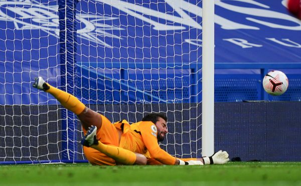 Liverpool's goalkeeper Alisson Becker saves a penalty kick during the FA Premier League match between Chelsea FC and Liverpool FC at Stamford Bridge. The game was played behind closed doors due to the UK government's social distancing laws during the Coronavirus COVID-19 Pandemic. (Pic by Propaganda)