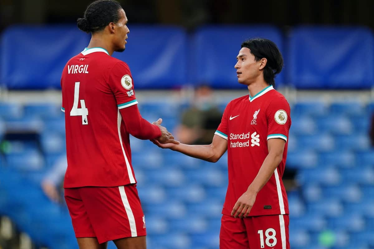 LONDON, ENGLAND - Sunday, September 20, 2020: Liverpool's Virgil van Dijk (L) and Takumi Minamino at the final whistle during the FA Premier League match between Chelsea FC and Liverpool FC at Stamford Bridge. The game was played behind closed doors due to the UK government's social distancing laws during the Coronavirus COVID-19 Pandemic. (Pic by Propaganda)