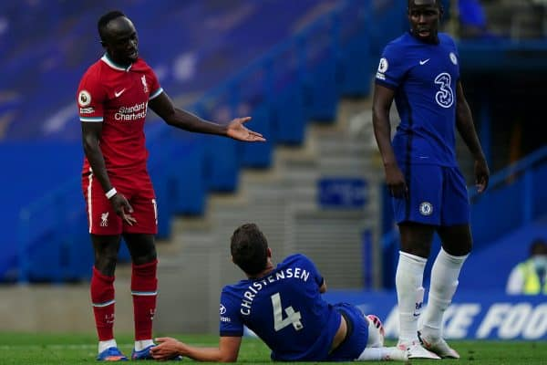 LONDON, ENGLAND - Sunday, September 20, 2020: Liverpool's Sadio Mané (L) speaks with Chelsea's captain Andreas Christensen after being fouled, the Chelse player was later shown a red card for the challenge after a VAT review, during the FA Premier League match between Chelsea FC and Liverpool FC at Stamford Bridge. The game was played behind closed doors due to the UK government's social distancing laws during the Coronavirus COVID-19 Pandemic. (Pic by Propaganda)