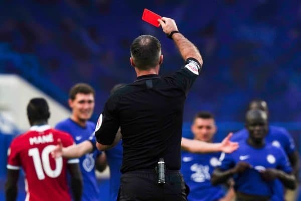 Referee Paul Tierney shows a red card to Chelsea's Andreas Christensen (hidden) during the FA Premier League match between Chelsea FC and Liverpool FC at Stamford Bridge. The game was played behind closed doors due to the UK government's social distancing laws during the Coronavirus COVID-19 Pandemic. (Pic by Propaganda)