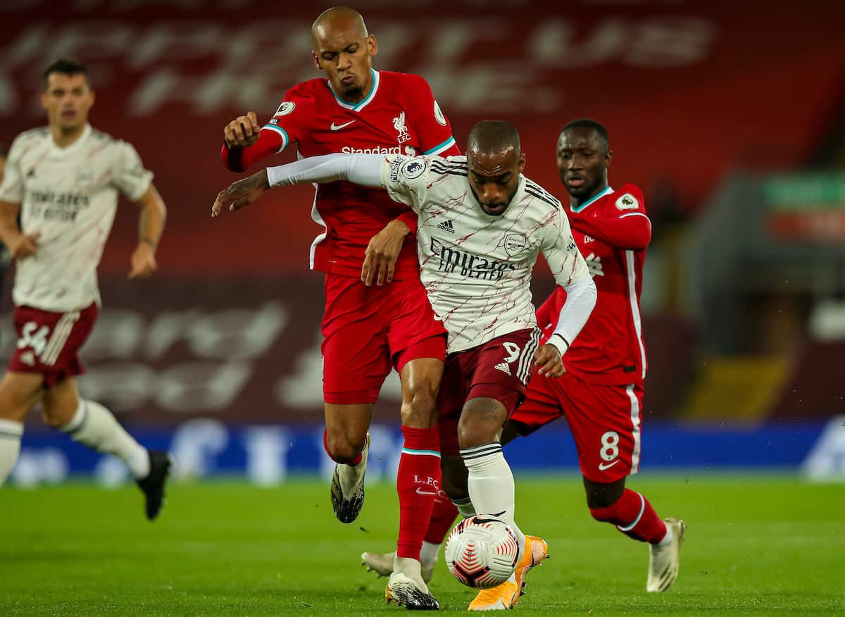 LIVERPOOL, ENGLAND - Monday, September 28, 2020: Liverpool's Fabio Henrique Tavares 'Fabinho' (L) challenges Arsenal's Alexandre Lacazette during the FA Premier League match between Liverpool FC and Arsenal FC at Anfield. The game was played behind closed doors due to the UK government's social distancing laws during the Coronavirus COVID-19 Pandemic. (Pic by Propaganda)