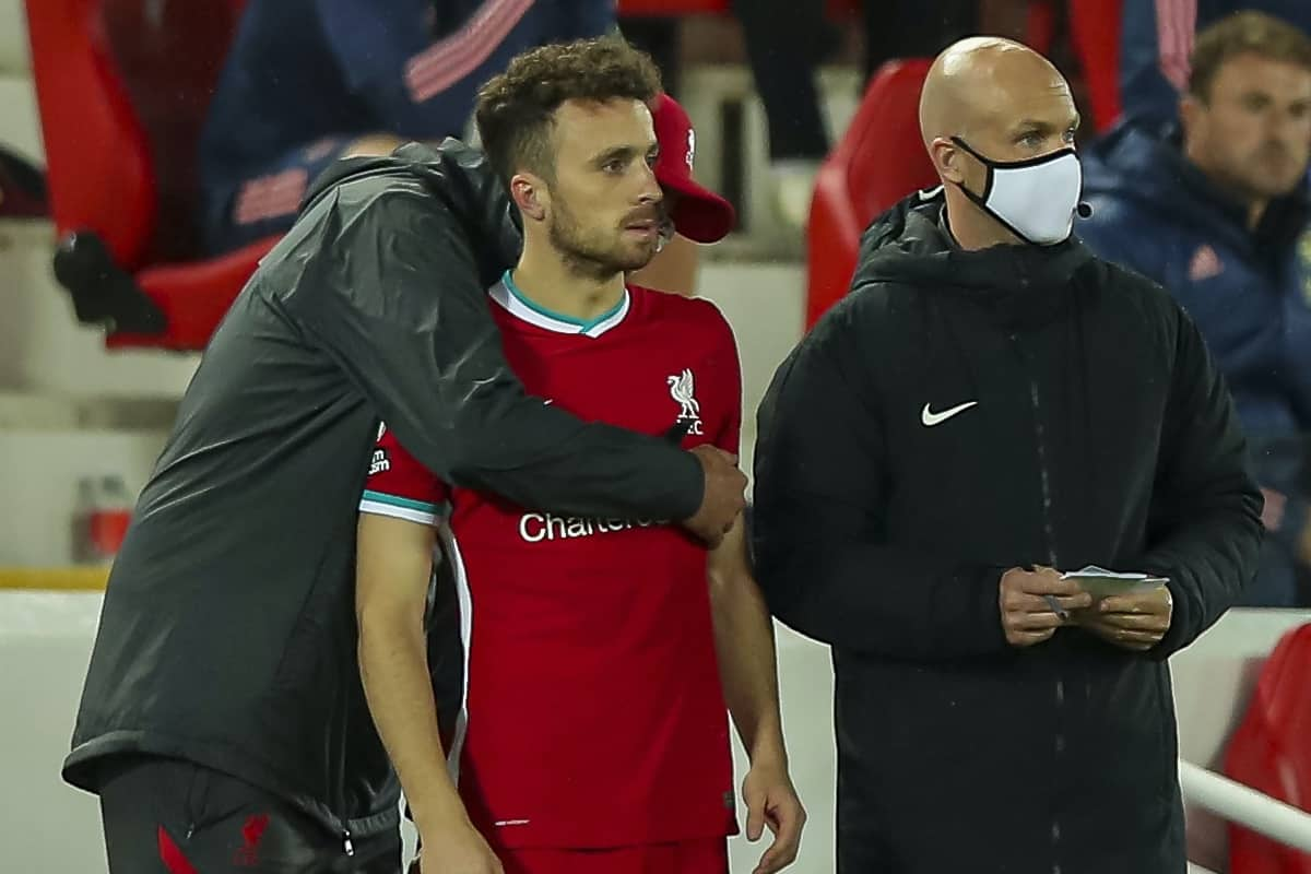 LIVERPOOL, ENGLAND - Monday, September 28, 2020: Liverpool's Diogo Jota is hugged by manager Jürgen Klopp before he comes on as a substitute during the FA Premier League match between Liverpool FC and Arsenal FC at Anfield. The game was played behind closed doors due to the UK government's social distancing laws during the Coronavirus COVID-19 Pandemic. (Pic by Propaganda)