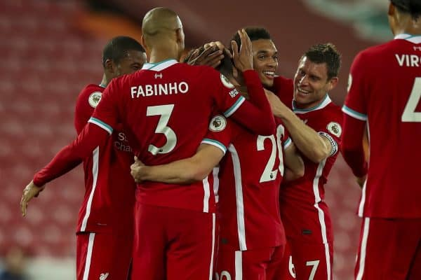 LIVERPOOL, ENGLAND - Monday, September 28, 2020: Liverpool players celebrate with goal-scorer Diogo Jota after he scores the third goal to make the score 3-1 during the FA Premier League match between Liverpool FC and Arsenal FC at Anfield. The game was played behind closed doors due to the UK government's social distancing laws during the Coronavirus COVID-19 Pandemic. (Pic by Propaganda)