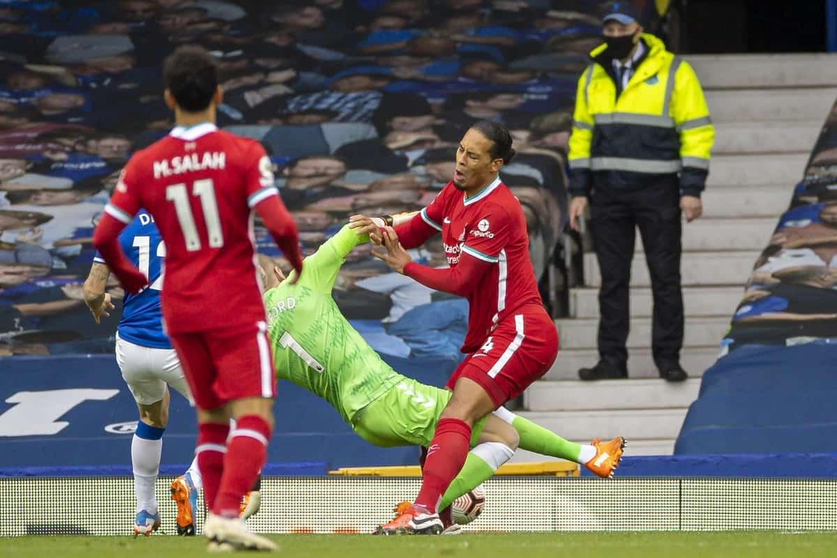 LIVERPOOL, ENGLAND - Saturday, October 17, 2020: Liverpool's Virgil van Dijk is fouled by Everton's goalkeeper Jordan Pickford during the FA Premier League match between Everton FC and Liverpool FC, the 237th Merseyside Derby, at Goodison Park. The game was played behind closed doors due to the UK government's social distancing laws during the Coronavirus COVID-19 Pandemic. (Pic by David Rawcliffe/Propaganda)