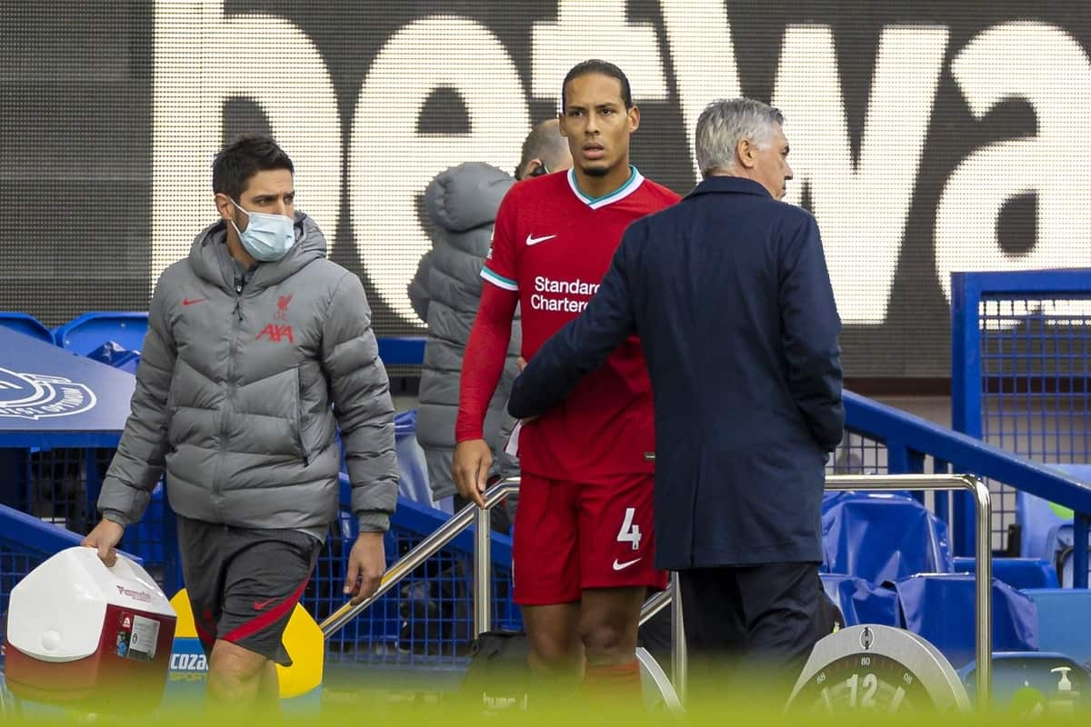 LIVERPOOL, ENGLAND - Saturday, October 17, 2020: Liverpool's Virgil van Dijk walks off injured past Everton's manager Carlo Ancelotti during the FA Premier League match between Everton FC and Liverpool FC, the 237th Merseyside Derby, at Goodison Park. The game was played behind closed doors due to the UK government's social distancing laws during the Coronavirus COVID-19 Pandemic. (Pic by David Rawcliffe/Propaganda)
