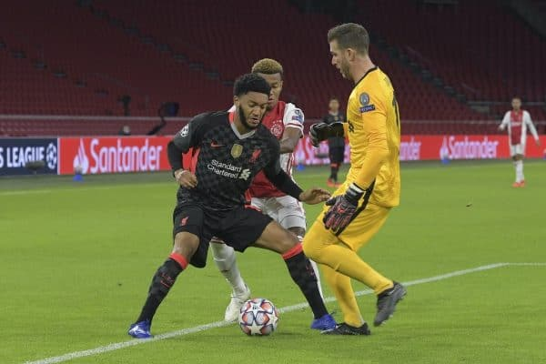 AMSTERDAM, THE NETHERLANDS - Wednesday, October 21, 2020: A mix-up between Liverpool's Joe Gomez (L) and goalkeeper Adrián San Miguel del Castillo during the opening UEFA Champions League Group D match between AFC Ajax and Liverpool FC at the Johan Cruijff ArenA. (Pic by Gerrit van Keulen/Orange Pictures via Propaganda)