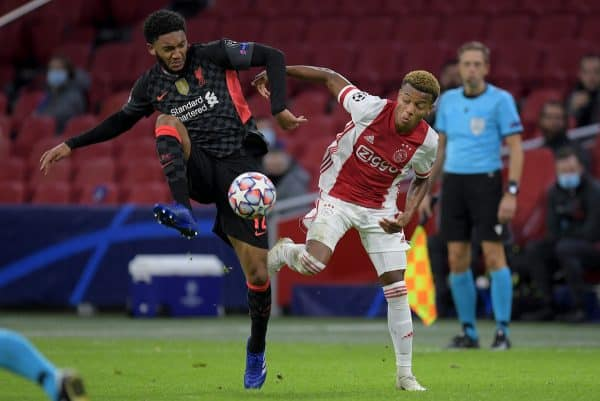 AMSTERDAM, THE NETHERLANDS - Wednesday, October 21, 2020: Liverpool's Joe Gomez (L) and Ajax's David Neres during the opening UEFA Champions League Group D match between AFC Ajax and Liverpool FC at the Johan Cruijff ArenA. (Pic by Gerrit van Keulen/Orange Pictures via Propaganda)