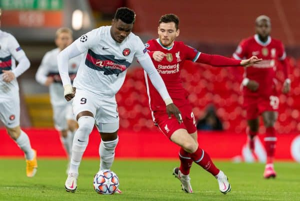 LIVERPOOL, ENGLAND - Tuesday, October 27, 2020: FC Midtjylland's Sory Kaba (L) and Liverpool's Andy Robertson during the UEFA Champions League Group D match between Liverpool FC and FC Midtjylland at Anfield. (Pic by David Rawcliffe/Propaganda)