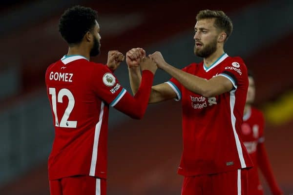 LIVERPOOL, ENGLAND - Saturday, October 31, 2020: Liverpool's Nathaniel Phillips (R) with Joe Gomez before making his debut during the FA Premier League match between Liverpool FC and West Ham United FC at Anfield. The game was played behind closed doors due to the UK government's social distancing laws during the Coronavirus COVID-19 Pandemic. (Pic by Propaganda)