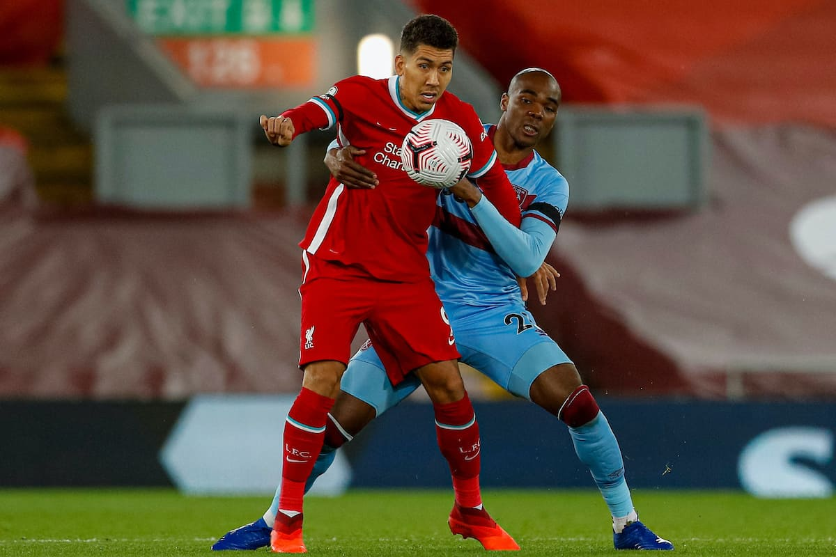 LIVERPOOL, ENGLAND - Saturday, October 31, 2020: Liverpool's Roberto Firmino (L) and West Ham United's Angelo Ogbonna during the FA Premier League match between Liverpool FC and West Ham United FC at Anfield. The game was played behind closed doors due to the UK government's social distancing laws during the Coronavirus COVID-19 Pandemic. (Pic by Propaganda)