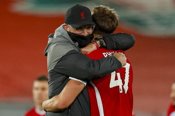 LIVERPOOL, ENGLAND - Saturday, October 31, 2020: Liverpool's manager Jürgen Klopp embraces Nathaniel Phillips after his Premier League debut during the FA Premier League match between Liverpool FC and West Ham United FC at Anfield. The game was played behind closed doors due to the UK government's social distancing laws during the Coronavirus COVID-19 Pandemic. (Pic by Propaganda)