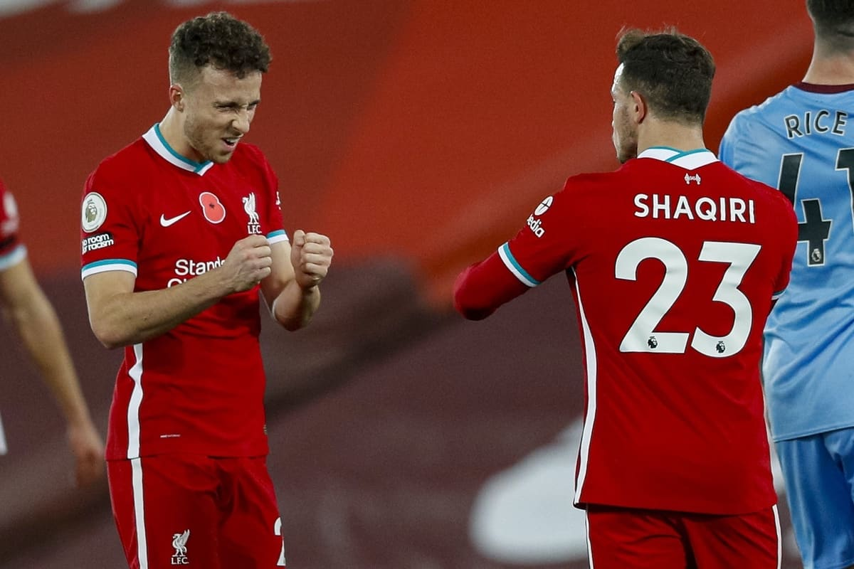 LIVERPOOL, ENGLAND - Saturday, October 31, 2020: Liverpool's match winning goal-scorer Diogo Jota (L) celebrates with Xherdan Shaqiri at the final whistle during the FA Premier League match between Liverpool FC and West Ham United FC at Anfield. The game was played behind closed doors due to the UK government's social distancing laws during the Coronavirus COVID-19 Pandemic. (Pic by Propaganda)