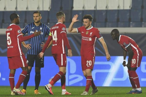 BERGAMO, ITALY - Tuesday, November 3, 2020: Liverpool's Diogo Jota (R) celebrates with team-mate captain Jordan Henderson after scoring the fifth goal, completing his hat-trick, during the UEFA Champions League Group D match between Atalanta BC and Liverpool FC at the Stadio di Bergamo. (Pic by Simone Arveda/Propaganda)
