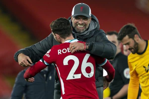 LIVERPOOL, ENGLAND - Sunday, November 22, 2020: Liverpool's manager Jürgen Klopp embraces Andy Robertson after the FA Premier League match between Liverpool FC and Leicester City FC at Anfield. The game was played behind closed doors due to the UK government's social distancing laws during the Coronavirus COVID-19 Pandemic. Liverpool won 3-0. (Pic by David Rawcliffe/Propaganda)