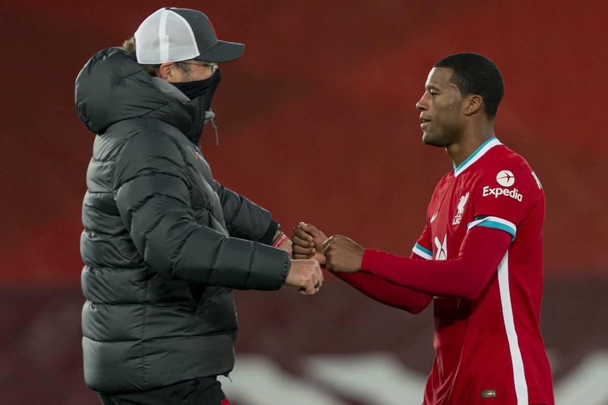 LIVERPOOL, ENGLAND - Sunday, November 22, 2020: Liverpool's manager Jürgen Klopp celebrates with Georginio Wijnaldum (R) after the FA Premier League match between Liverpool FC and Leicester City FC at Anfield. The game was played behind closed doors due to the UK government's social distancing laws during the Coronavirus COVID-19 Pandemic. Liverpool won 3-0. (Pic by David Rawcliffe/Propaganda)
