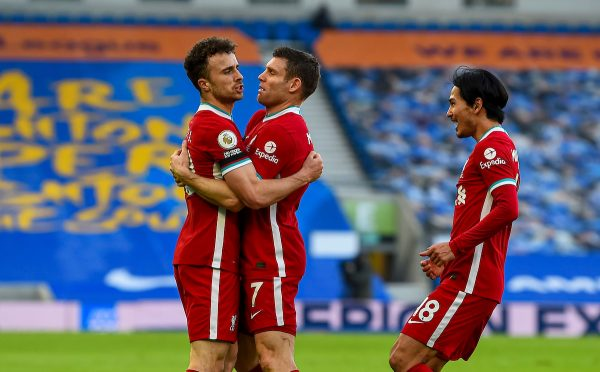 Liverpool's Diogo Jota (L) celebrates with team-mates James Milner (C) and Takumi Minamino (R) after scoring the first goal during the FA Premier League match between Brighton & Hove Albion FC and Liverpool FC at the AMEX Stadium. The game was played behind closed doors due to the UK government's social distancing laws during the Coronavirus COVID-19 Pandemic. (Pic by Propaganda)
