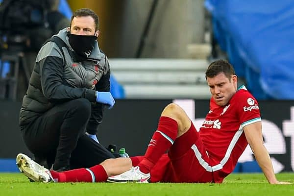 BRIGHTON & HOVE, ENGLAND - Saturday, November 28, 2020: Liverpool's James Milner is treated for an injury during the FA Premier League match between Brighton & Hove Albion FC and Liverpool FC at the AMEX Stadium. The game was played behind closed doors due to the UK government's social distancing laws during the Coronavirus COVID-19 Pandemic. (Pic by Propaganda)