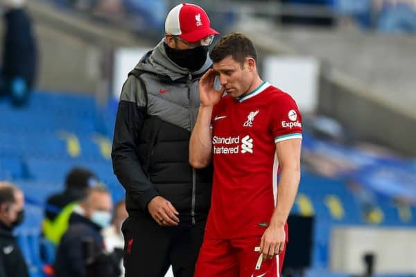 Liverpool's James Milner walks past manager Jürgen Klopp as he goes off injured during the FA Premier League match between Brighton & Hove Albion FC and Liverpool FC at the AMEX Stadium. The game was played behind closed doors due to the UK government's social distancing laws during the Coronavirus COVID-19 Pandemic. (Pic by Propaganda)