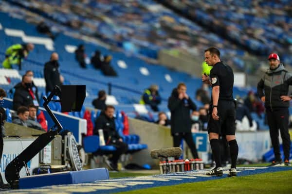 Referee Stuart Atwell looks at the VAR monitor before awarding Brighton & Hove Albion a penalty during the FA Premier League match between Brighton & Hove Albion FC and Liverpool FC at the AMEX Stadium. The game was played behind closed doors due to the UK government's social distancing laws during the Coronavirus COVID-19 Pandemic. (Pic by Propaganda)