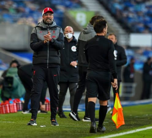 BRIGHTON & HOVE, ENGLAND - Saturday, November 28, 2020: Liverpool's manager Jürgen Klopp and goalkeeper Alisson Becker fist bump referee Stuart Atwell after the FA Premier League match between Brighton & Hove Albion FC and Liverpool FC at the AMEX Stadium. The game was played behind closed doors due to the UK government's social distancing laws during the Coronavirus COVID-19 Pandemic. (Pic by Propaganda)