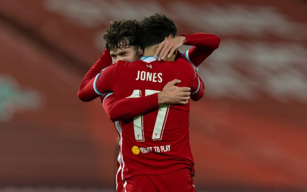 LIVERPOOL, ENGLAND - Tuesday, December 1, 2020: Liverpool's Curtis Jones celebrates after scoring the winning goal with team-mate Neco Williams (L) during the UEFA Champions League Group D match between Liverpool FC and AFC Ajax at Anfield. Liverpool won 1-0 and qualified for the Round of 16. (Pic by David Rawcliffe/Propaganda)