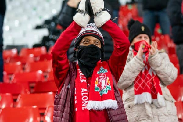 LIVERPOOL, ENGLAND - Sunday, December 6, 2020: A Liverpool supporter on the Spion Kop greets the players as the club prepare to welcome 2,000 spectators back into the stadium, pictured before the FA Premier League match between Liverpool FC and Wolverhampton Wanderers FC at Anfield. (Pic by David Rawcliffe/Propaganda)