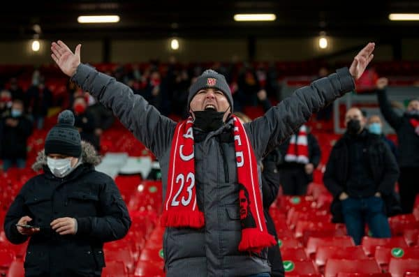 LIVERPOOL, ENGLAND - Sunday, December 6, 2020: A Liverpool supporter cheers on the players as they warm-up as the club welcomes 2,000 spectators back into the stadium, pictured before the FA Premier League match between Liverpool FC and Wolverhampton Wanderers FC at Anfield. (Pic by David Rawcliffe/Propaganda)