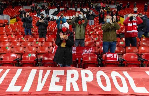 LIVERPOOL, ENGLAND - Sunday, December 6, 2020: A supporter of Liverpool encourages players as they heat up when the club welcomes back 2,000 spectators in the stadium, photographed before the match of the FA Premier League match between Liverpool and Wolverhampton Wanderers FC at Anfield.  (Photo by David Rawcliffe / Propaganda)