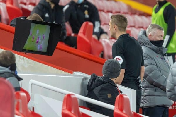 LIVERPOOL, ENGLAND - Sunday, December 6, 2020: Referee Craig Pawson looks at a replay on the VAR monitor and reverses his decision to award Wolverhampton Wanderers a penalty during the FA Premier League match between Liverpool FC and Wolverhampton Wanderers FC at Anfield. (Pic by David Rawcliffe/Propaganda)