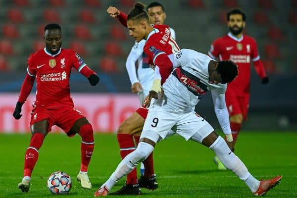 HERNING, DENMARK - Wednesday, December 9, 2020: Liverpool's Rhys Williams tackles FC Midtjylland's Sory Kaba (R) during the UEFA Champions League Group D match between FC Midtjylland and Liverpool FC at the Herning Arena. (Pic by Lars Møller/Propaganda)