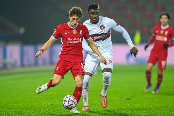HERNING, DENMARK - Wednesday, December 9, 2020: Liverpool's Kostas Tsimikas (L) and FC Midtjylland's Sory Kaba during the UEFA Champions League Group D match between FC Midtjylland and Liverpool FC at the Herning Arena. (Pic by Lars Møller/Propaganda)