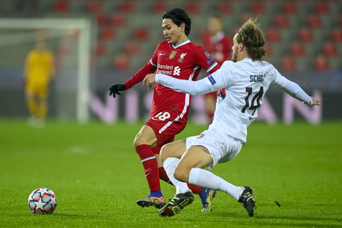 HERNING, DENMARK - Wednesday, December 9, 2020: Liverpool's Takumi Minamino (L) is challenged by FC Midtjylland's Alexander Scholz during the UEFA Champions League Group D match between FC Midtjylland and Liverpool FC at the Herning Arena. (Pic by Lars Møller/Propaganda)