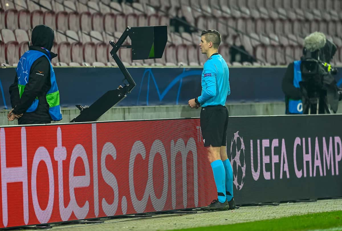 HERNING, DENMARK - Wednesday, December 9, 2020: Referee Franc?ois Letexier checks a VAR review before awarding FC Midtjylland a penalty during the UEFA Champions League Group D match between FC Midtjylland and Liverpool FC at the Herning Arena. (Pic by Lars Møller/Propaganda)