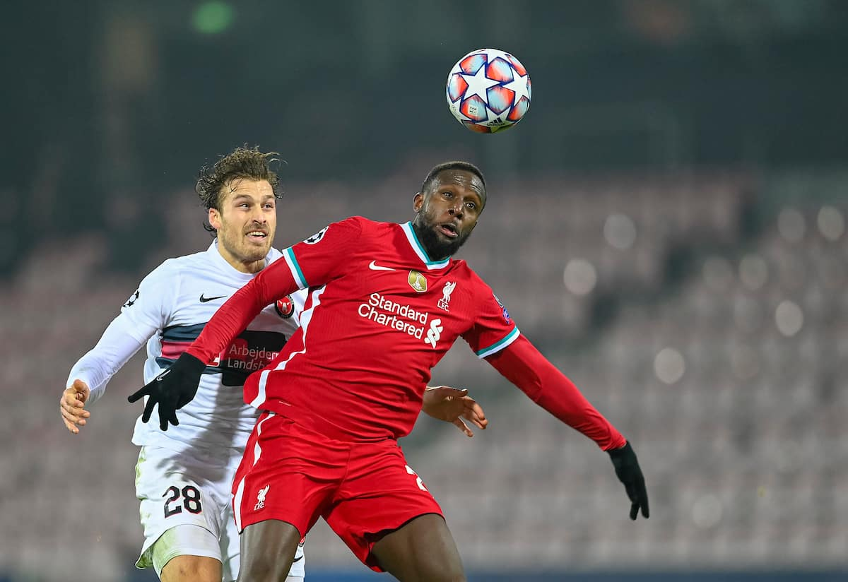 HERNING, DENMARK - Wednesday, December 9, 2020: Liverpool's Divock Origi (R) challenges for a header with FC Midtjylland's Erik Sviatchenko during the UEFA Champions League Group D match between FC Midtjylland and Liverpool FC at the Herning Arena. (Pic by Lars Møller/Propaganda)