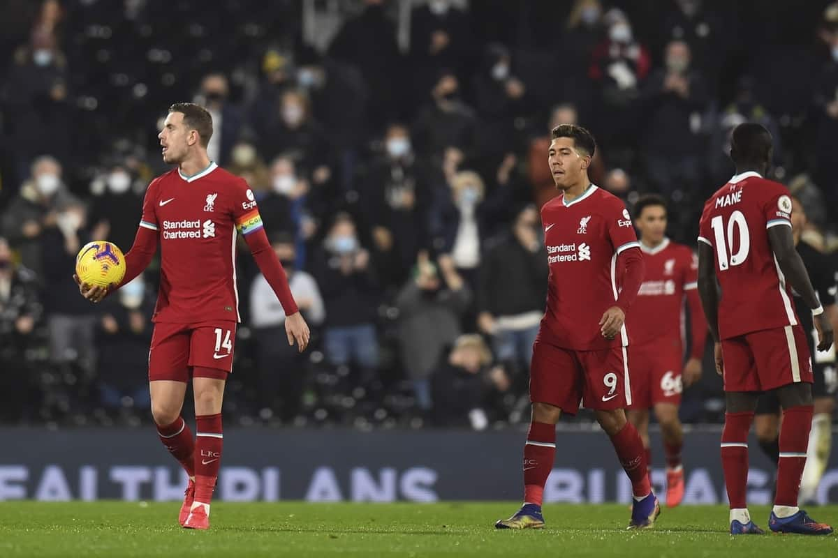LONDON, ENGLAND - Sunday, December 13, 2020: Liverpool's captain Jordan Henderson and Roberto Firmino look dejected as Fulham score the opening goal during the FA Premier League match between Fulham FC and Liverpool FC at Craven Cottage. (Pic by David Rawcliffe/Propaganda)