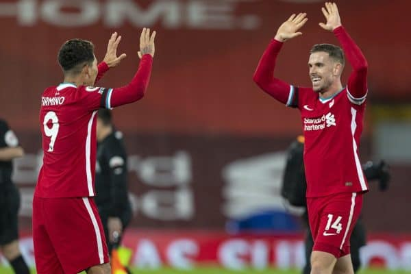LIVERPOOL, ENGLAND - Wednesday, December 16, 2020: Liverpool's captain Jordan Henderson (R) celebrates with winning goal-scorer Roberto Firmino at the final whistle during the FA Premier League match between Liverpool FC and Tottenham Hotspur FC at Anfield. Liverpool won 2-1. (Pic by David Rawcliffe/Propaganda)