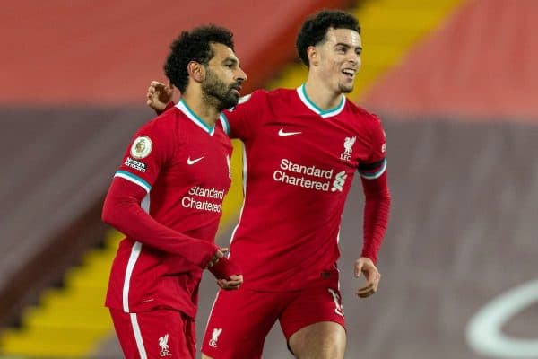 LIVERPOOL, ENGLAND - Wednesday, December 16, 2020: Liverpool's Mohamed Salah (L) celebrates after scoring the first goal with team-mate Curtis Jones during the FA Premier League match between Liverpool FC and Tottenham Hotspur FC at Anfield. (Pic by David Rawcliffe/Propaganda)