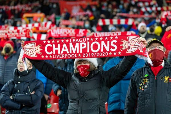 """LIVERPOOL, ENGLAND - Wednesday, December 16, 2020: Liverpool supporters sing """"You'll Never Walk Alone"""" on the Spion Kop before the FA Premier League match between Liverpool FC and Tottenham Hotspur FC at Anfield. (Pic by David Rawcliffe/Propaganda)"""