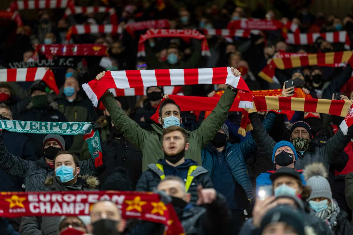 """LIVERPOOL, ENGLAND - Sunday, December 27, 2020: Liverpool supporters on the Spion Kop sing """"You'll Never Walk Alone"""" before the FA Premier League match between Liverpool FC and West Bromwich Albion FC at Anfield. (Pic by David Rawcliffe/Propaganda)"""