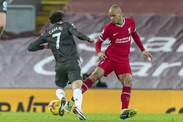LIVERPOOL, ENGLAND - Sunday, January 17, 2021: Liverpool's Fabio Henrique Tavares 'Fabinho' tackles Manchester United's Edinson Cavani during the FA Premier League match between Liverpool FC and Manchester United FC at Anfield. (Pic by David Rawcliffe/Propaganda)