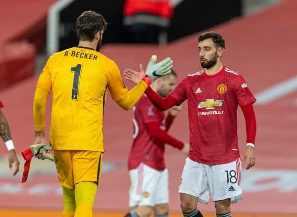 LIVERPOOL, ENGLAND - Sunday, January 24, 2021: Liverpool's goalkeeper Alisson Becker (L) with Manchester United's Bruno Fernandes after the FA Cup 4th Round match between Manchester United FC and Liverpool FC at Old Trafford. Manchester United won 3-2. (Pic by David Rawcliffe/Propaganda)