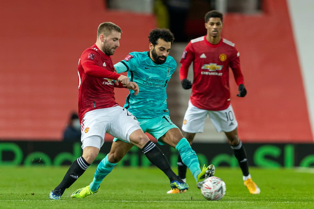 LIVERPOOL, ENGLAND - Sunday, January 24, 2021: Manchester United's Luke Shaw (L) and Liverpool's Mohamed Salah during the FA Cup 4th Round match between Manchester United FC and Liverpool FC at Old Trafford. (Pic by David Rawcliffe/Propaganda)