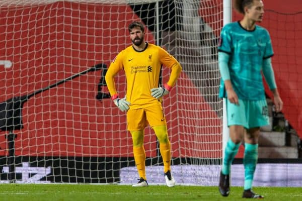 LIVERPOOL, ENGLAND - Sunday, January 24, 2021: Liverpool's goalkeeper Alisson Becker looks dejected as Manchester United score the first equalising goal during the FA Cup 4th Round match between Manchester United FC and Liverpool FC at Old Trafford. (Pic by David Rawcliffe/Propaganda)